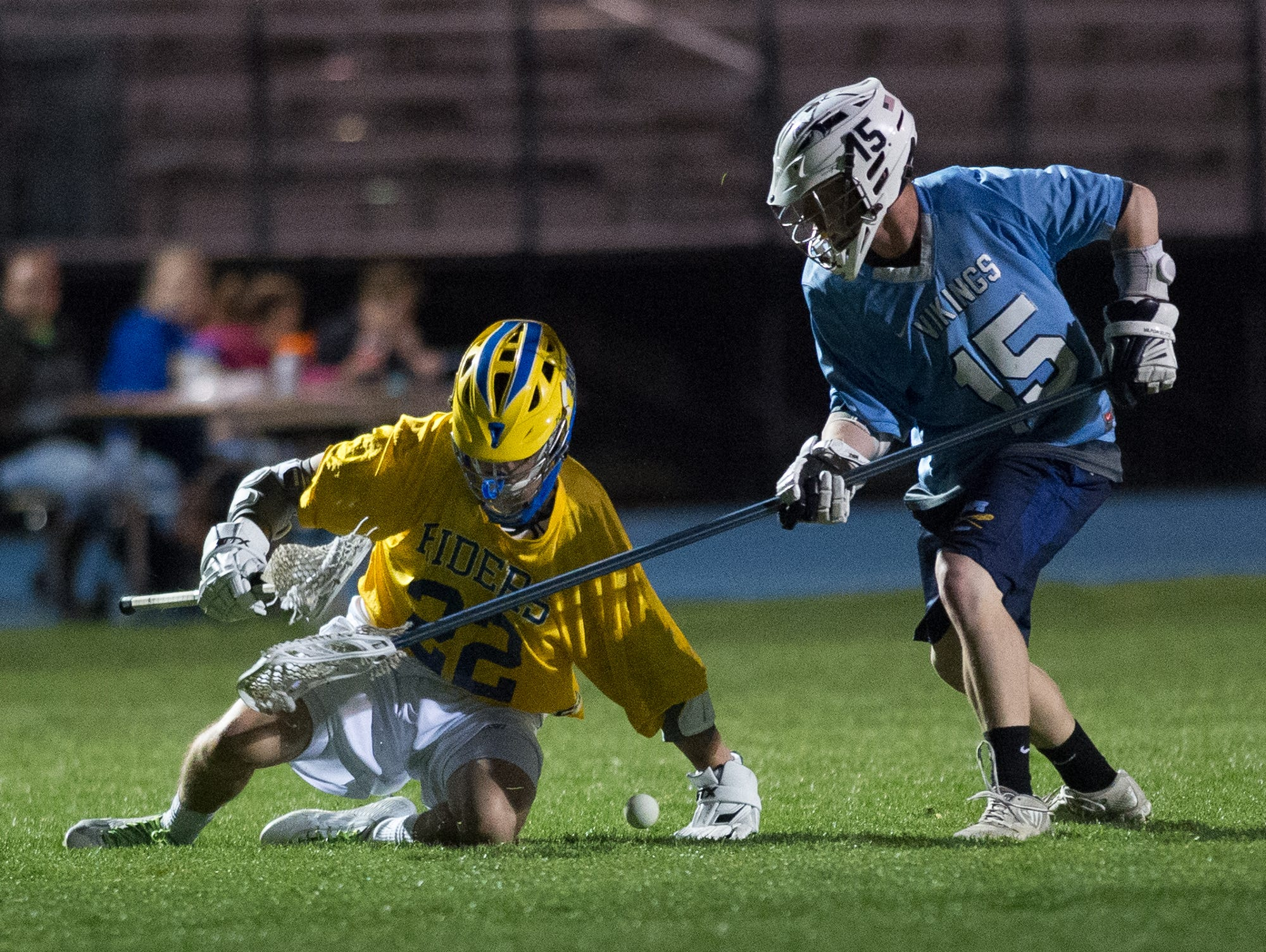 Cape Henlopen's Nicholas Conrad (15), right knocks the ball away from Caesar Rodney's Jacob Pangle (22) in the 4th quarter of play.