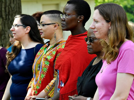 From right, Stephanie Oelrich, Ophelia Chambliss, both of Manchester, Victoria Kageni-Woodard, Shannon High Patterson, and Kristin Cole, all of York City, gather with other community activists in support as members of York City mosque Masjid Taw Heed gather for prayer marking the end of Ramadan at Brookside Park in Dover, Wednesday, July 6, 2016. Dawn J. Sagert photo