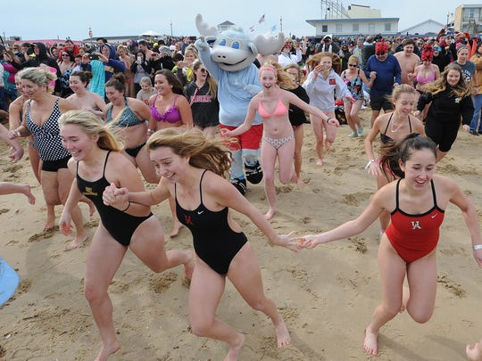 Delaware State Police dive team is on hand every year to keep a watchful eye over Polar Bear plungers in Rehoboth Beach.