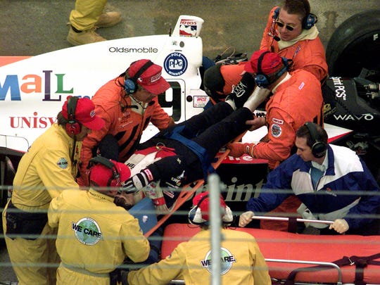 10-18-1999 5c; Sam Schmidt is removed from his car after crashing in the IRL Mall.com 500 on Sunday Oct. 17, 1999, in Fort Worth, Texas. Schmidt broke his left foot and fractured a toe on his right foot. (AP Photo/L.M. Otero)