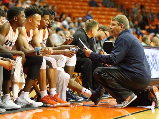UTEP head basketball coach Tim Floyd talks to the White