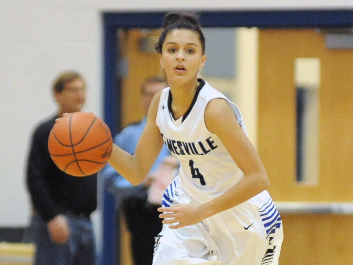 Zanesville's Destiny Johnson brings the ball down court during a Division I sectional tournament game against Watkins Memorial last season at Winland Memorial Gymnasium. Johnson is one of seven returning lettermen for the Lady Devils this season.