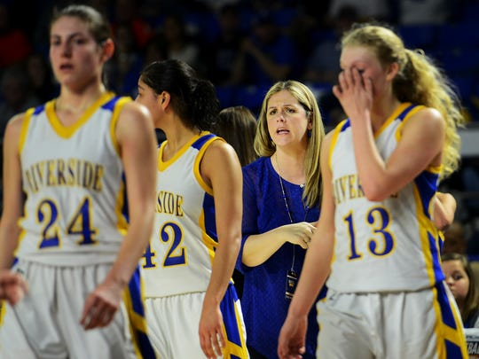 Riverside High School girls' head basketball coach Nicole Courtney speaks to her team after a timeout during their TSSAA Class A quarterfinal game against Oliver Springs, Friday.