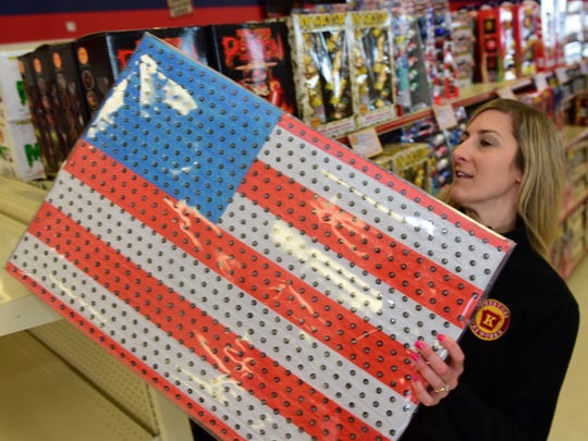 Danelle Hayer, manager at Keystone Fireworks, Greencastle, stocks shelves Monday, Feb. 22, 2016 with Xtreme Missle Battery, fireworks that cannot be purchased by customers with Pennsylvania identification. State legislature is considering a bill to allow Pennsylvanians to buy roman candles, etc. and other previously banned fireworks in state.