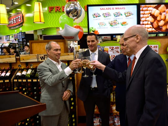 Sheetz board director Louie Sheetz, left, toasts with