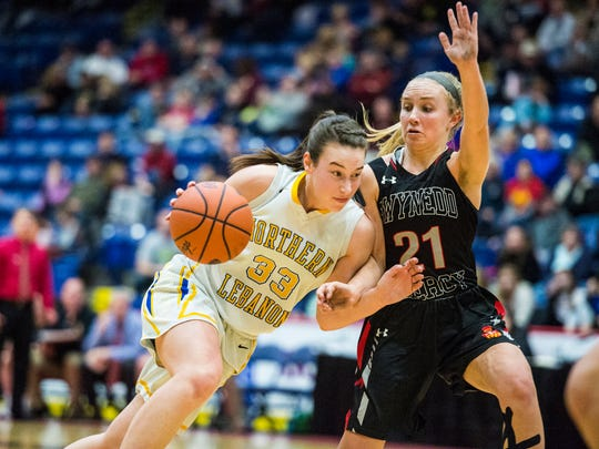 Northern Lebanon's Zoe Zerman drives the lane against Gwynedd Mercy's Maura Conroy as Northern Lebanon fell to Gwynedd Mercy Academy 43-42 in the PIAA 4A quarterfinals at Santander Arena in Reading, Pa. on  Sunday, March 19, 2017.