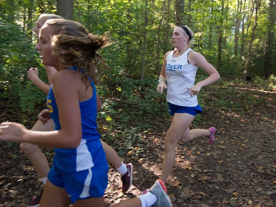 Dover High cross-country runner Emily Cook, who competes successfully with Type 1 diabetes, works her way through a wooded part of the course at Schutte Park in Dover.