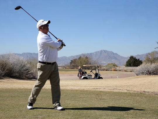 """Robert Martinez watches his tee shot during a February golf outing at the Butterfield Trail Golf Club in East El Paso. Martinez says the 18-hole course, owned and operated by the El Paso airport, is """"beautiful."""""""