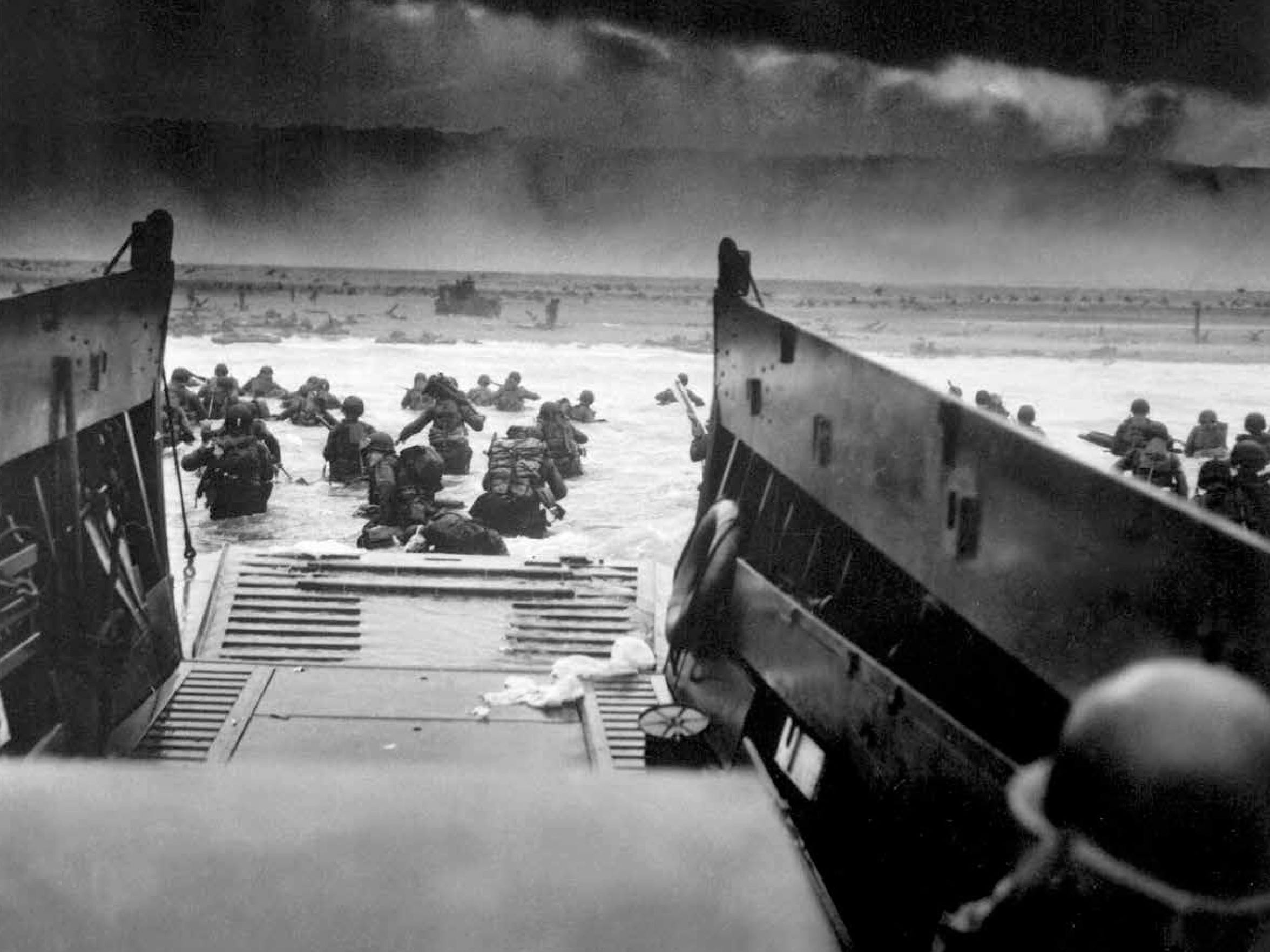 A view from a Coast Guard barge hitting the French coast with the first waves of D-Day invaders. American fighting men waded ashore under Nazi machine-gun fire on June 6, 1944.