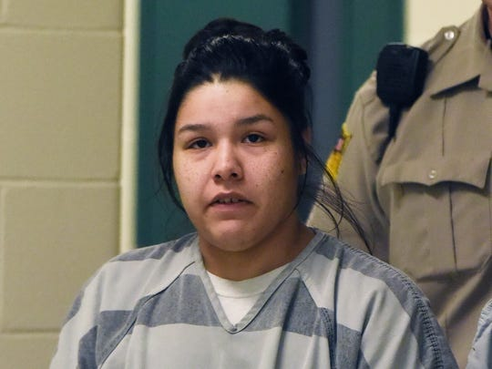 Mercedes Red Bear is escorted to Minnehaha County Court Thursday, April 28, 2016.