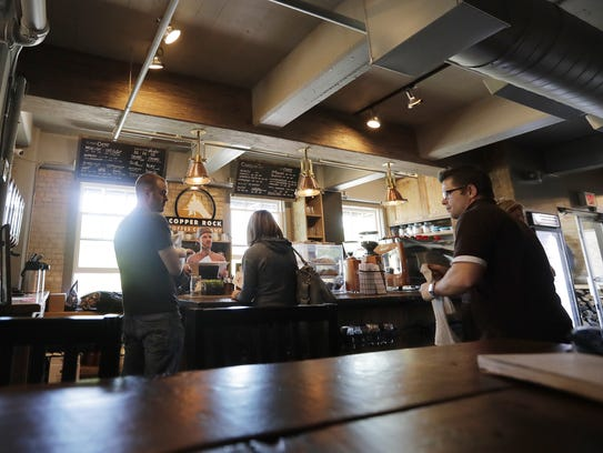 Customers wait for their coffee orders at Copper State