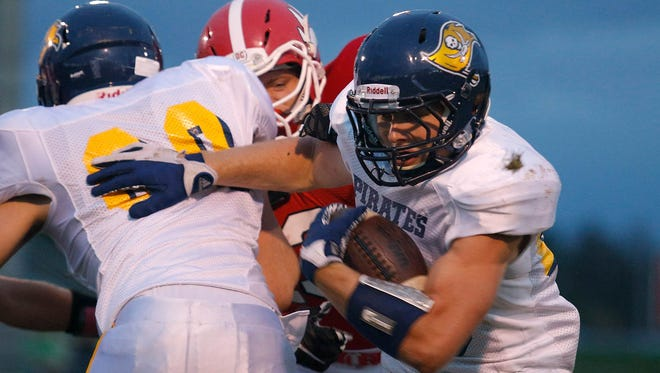 Pewamo-Westphalia junior Jared Smith, right, has set the state record for rushing TDs in a season and is near the record for rushing yards in a season.