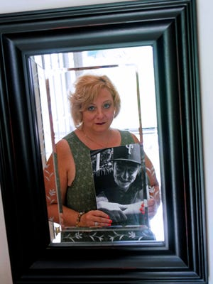 Penny Rogers holds a picture of her 23-year-old son, Vincente Tambourelli, who died of a heroin overdose less than a month ago.