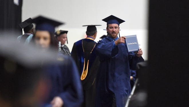 Travis Orr, of Fort Pierce, celebrates Saturday, May 6, 2017, after receiving his diploma during the Indian River State College graduation ceremony at the Havert L. Fenn Center in Fort Pierce. To see more photos, go to TCPalm.com.
