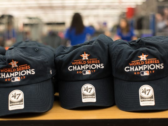 Astros World Series Champions hats sit on display at
