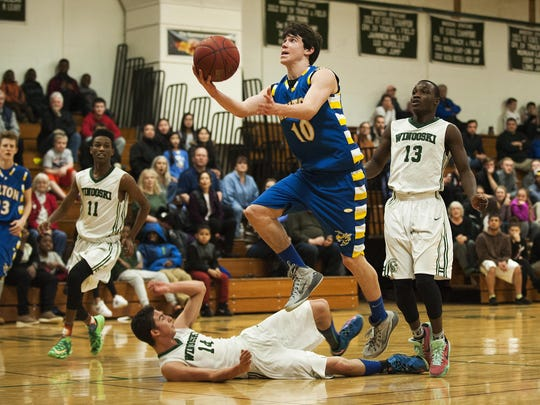 Milton's Ryan Brown (10) leaps for a lay up during
