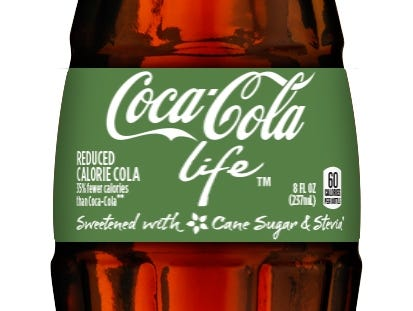 green is the new red for coke life opening