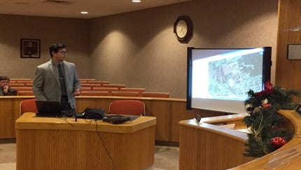 Paul Sabbagh, a Rowan University economics major, presents his virtual tour of properties in need of redevelopment to Clayton's mayor and council on Dec.10.
