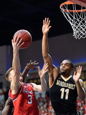 Belmont's Dylan Windler (3) tries to get around Vanderbilt's Jeff Roberson (11) in a game Nov. 13.