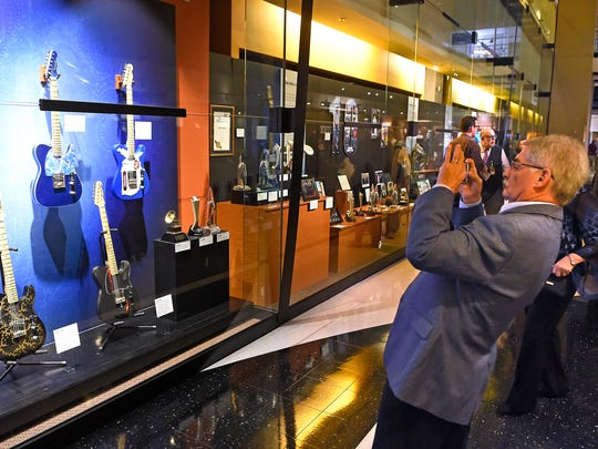 Doug Paisley takes some photos of his son Brad's new exhibit at the Country Music Hall of Fame and Museum on Thursday, Nov. 17, 2016.