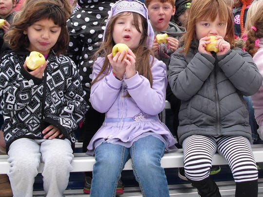 "The Random Lake School District recently partook in National School Lunch Week with the theme ""School Lunch Snapshot,"" which focused on sharing real images of student lunches. Students partook in National Crunch Day where students - like 5K students, from left, Madilyn Gerken, Myleigh Baumann and Riley Ahrens - were given a locally-grown apple to bite into at the same time."