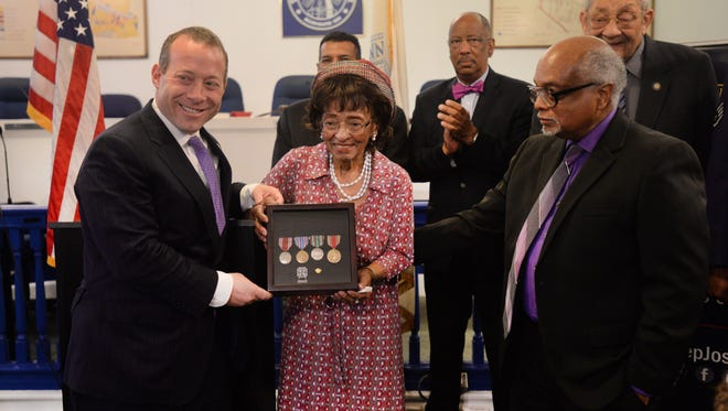 Carolyn Witherspoon (center) with Rep. Josh Gottheimer (left) and her son Roger Witherspoon (right)