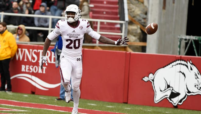Mississippi State receiver Reggie Todd celebrates after scoring a touchdown against Arkansas during the second half of an NCAA college football game Saturday, Nov. 18, 2017, in Fayetteville, Ark. (AP Photo/Michael Woods)
