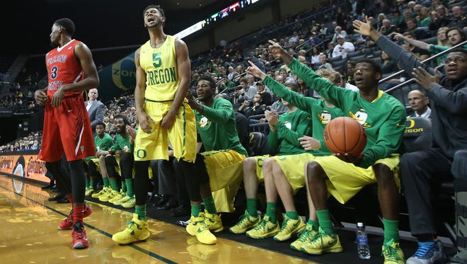 Oregon's Tyler Dorsey, center, let out a celebratory yell as an out of bounds calls goes to the Ducks during first half of an NCAA college basketball game against Fresno State Monday, Nov. 30, 2015, in Eugene.