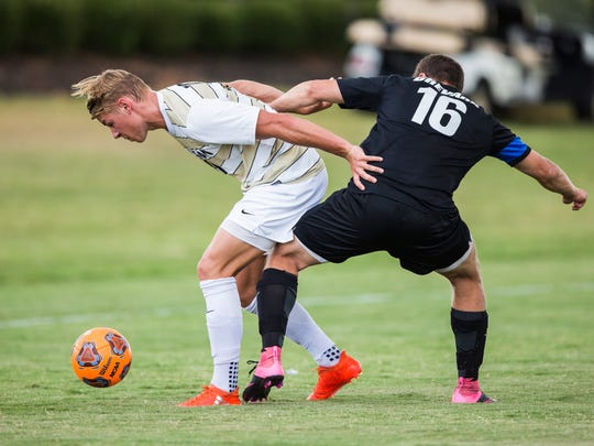 Anderson University senior forward Lars Kaula fights for possession of the ball against Brevard's Chris Efenecy as AU takes on Brevard on Wednesday, September 21, 2016 in Anderson.