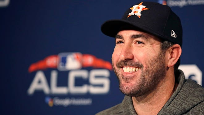 Houston Astros starting pitcher Justin Verlander smiles during a news conference prior to a workout at Fenway Park, Friday, Oct. 12, 2018, in Boston. The Astros face the Boston Red Sox in Game 1 of baseball's American League Championship Series on Saturday. (AP Photo/Charles Krupa)
