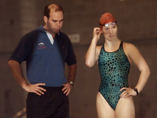 Fairport swimmer, Lindsey Crane with coach Mike Kennedy.
