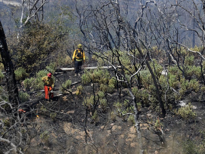 Fire Crews continue to clean up hot spots Monday off