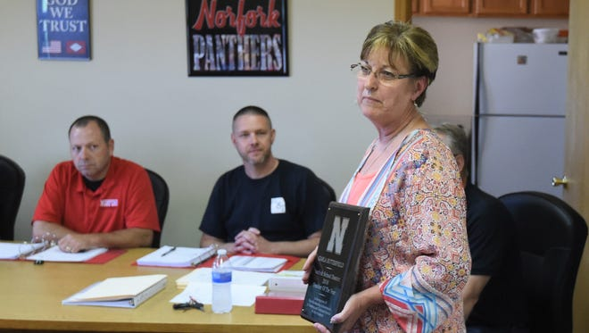 Carla Sutterfield (standing) accepts her plaque after being recognized as Norfork's Teacher of the Year at the May 17 school board meeting. Sutterfield teaches fourth- and sixth-grade literacy and has spent 10 years at Norfork. She has 33 years of teaching experience.