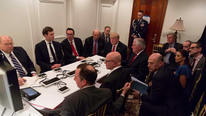 In this photo released by the White House Press Secretary Sean Spicer on Twitter, President Trump receives a briefing on the Syria military strike in a secured conference room at his Mar-a-Lago resort.