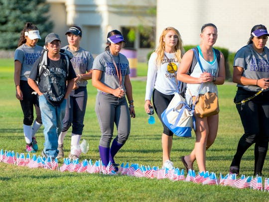 Western New Mexico University students participate in a remembrance walk during a memorial to commemorate the anniversary of the attacks on Sept. 11, 2001.
