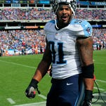 Titans outside linebacker Derrick Morgan (91) is escorted off the field after being ejected for unsportsmanlike conduct during the fourth quarter against the Browns at LP Field Sunday Oct. 5, 2014, in Nashville, Tenn.