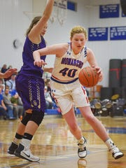 Warner's Laurie Rogers goes against Sully Buttes defense