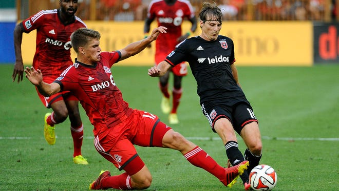 Toronto FC defender Nick Hagglund (17) defends DC United forward Chris Rolfe (18) during the first half at Robert F. Kennedy Memorial.