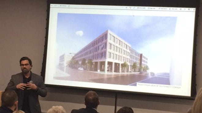 Architect Mike Suriano of NBBJ presented a concept for the Giant Eagle property in Schumacher Place in March. Some area residents balked at the plan, saying they wanted a grocery store to remain.