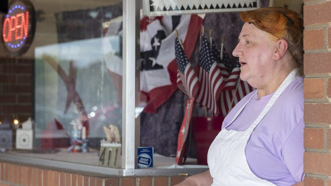"""Stahl's Bakery owner Cary James drew criticism from several people over a sign declaring intent to not have any intention of """"respecting new little laws"""" regarding COVID-19 actions in the bakery window. James has since covered the sign with her original Fourth of July patriotic sign."""