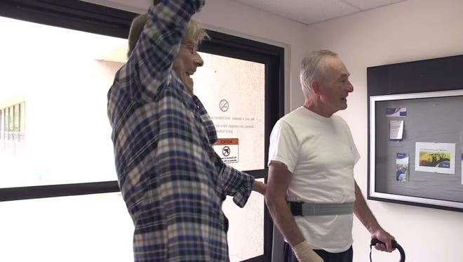 Bob Hills walks with the assistance of Esko, a new technology that helps patients walk again.