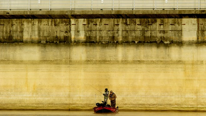 An angler fishes next to the Cherokee Dam during the second day of the Bassmaster Elite Series Tournament at Cherokee Lake in Jefferson County, Tennessee on Friday, February 10, 2017. Competition continues Saturday and Sunday, with Saturday and Sunday weigh-ins being held at the Convention Center in downtown Knoxville.