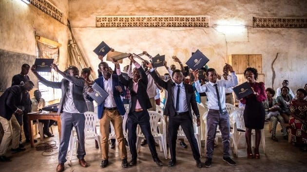 Refugees in Rwanda celebrating after earning degrees from Southern New Hampshire University.