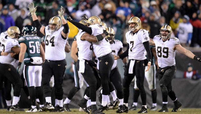 New Orleans Saints kicker Shayne Graham (3) celebrates the game-winning field goal against the Philadelphia Eagles in the fourth quarter of the 2013 NFC wild card playoff football game at Lincoln Financial Field.
