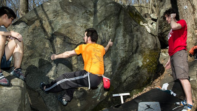 Climbers attack boulders in the Sourland Mountain Preserve at last year's Sourlands Smackdown. The state's only outdoor bouldering competition returns on April 8 in Hillsborough. Registration is available now online or at the event.