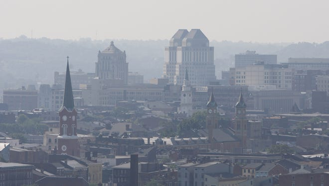 A haze of smog covers Over-the-Rhine looking Southeast from Fairview Park in Fairview in 2010.