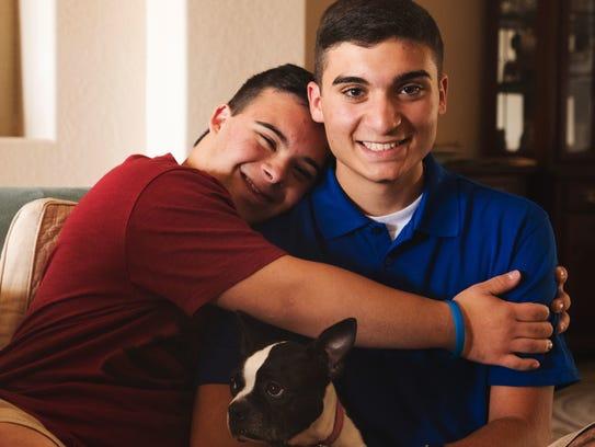 Johnny Ciocca, 17, right, a junior at Estero High School,
