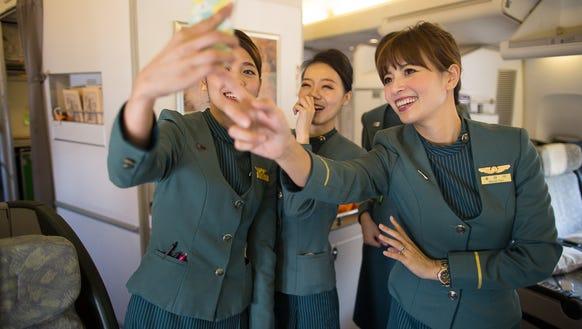 Flight attendants serving on EVA Air's last passenger