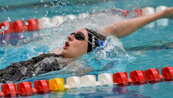 Dover-Sherborn's Ava Yablonski en route to winning the 100-yard backstroke championship during the Division 2 girls swimming and diving state meet at Boston University on Feb. 15. Yablonski's backstroke time of 54.44 seconds was the 33rd fastest time in the country, earning her All-American honors.