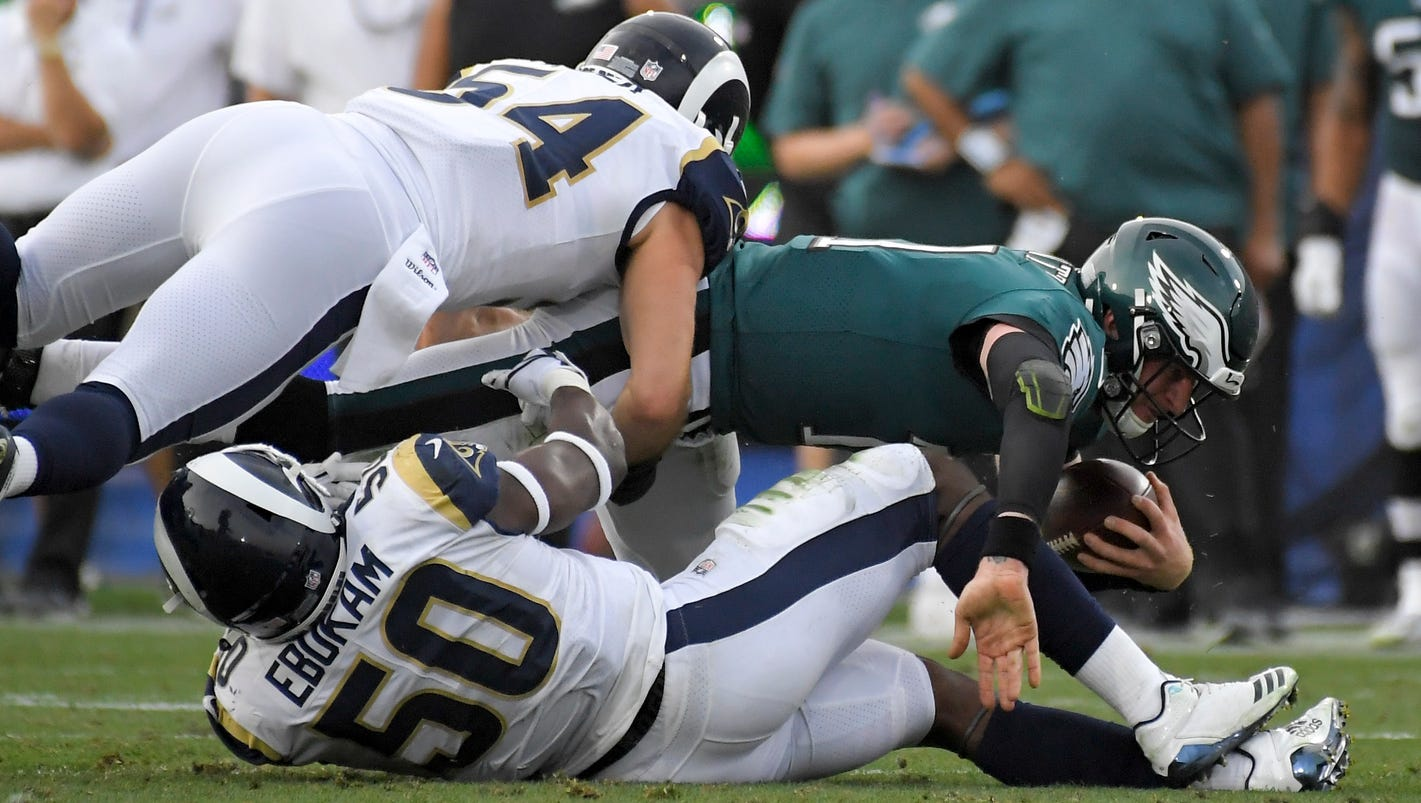 17a39fa297f Wentz threw for 291 yards and four touchdowns before leaving with an  injured left knee and Jake Elliott kicked the go-ahead 33-yard field goal  with 3:45 ...